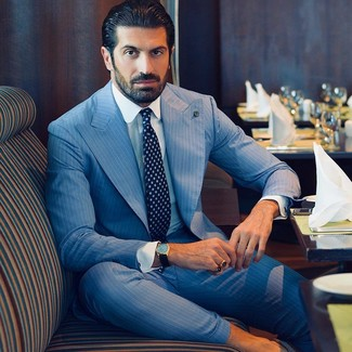 How to wear: navy print tie, white dress shirt, light blue vertical striped suit