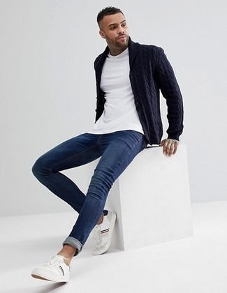 How to wear: navy shawl cardigan, white crew-neck t-shirt, navy skinny jeans, white leather low top sneakers