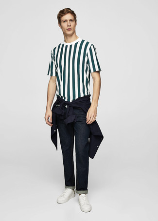 How to wear: navy shirt jacket, dark green vertical striped crew-neck t-shirt, navy jeans, white leather low top sneakers