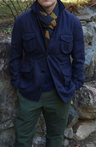 How to wear: navy wool shirt jacket, navy crew-neck sweater, dark green chinos, navy print scarf