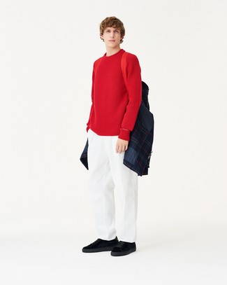 How to wear: navy quilted shirt jacket, red crew-neck sweater, white chinos, black suede low top sneakers