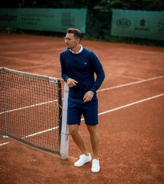 How to Wear a Navy Cable Sweater For Men: A navy cable sweater and navy shorts will convey this relaxed and dapper vibe. If you're hesitant about how to round off, introduce white low top sneakers to the equation.