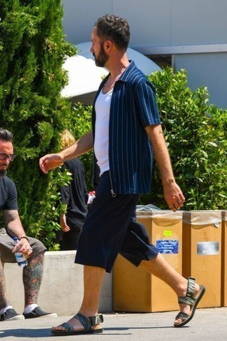 Men's Looks & Outfits: What To Wear In 2020: If you enjoy functional style, rock a navy vertical striped short sleeve shirt with navy shorts. Inject a hint of stylish nonchalance into your look by slipping into multi colored canvas sandals.