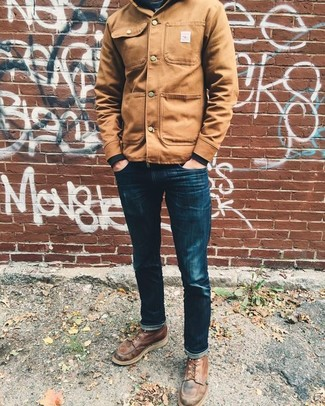 How to wear: brown leather casual boots, navy skinny jeans, black sweatshirt, tan shirt jacket