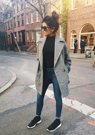 How to wear: black and white athletic shoes, navy skinny jeans, black turtleneck, grey coat