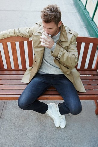 How to wear: white high top sneakers, navy skinny jeans, grey long sleeve t-shirt, beige trenchcoat