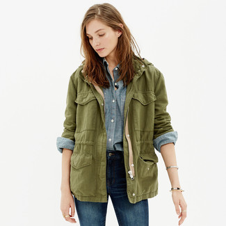 How to wear: navy skinny jeans, light blue chambray dress shirt, olive military jacket