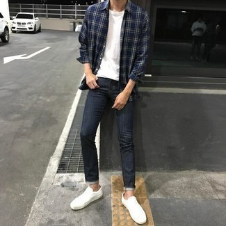 Men's Looks & Outfits: What To Wear In 2020: A navy plaid long sleeve shirt and navy skinny jeans are a nice combination to have in your current casual rotation. Don't know how to complete your look? Rock a pair of white low top sneakers to bump it up.