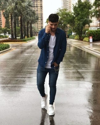 How to Wear White Leather Low Top Sneakers For Men: Exhibit your skills in men's fashion by teaming a navy long sleeve shirt and navy skinny jeans for a relaxed combination. White leather low top sneakers are a good idea to round off this getup.