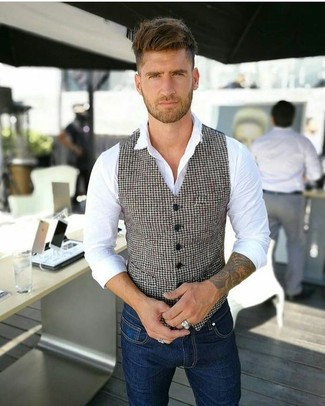 How to wear: navy skinny jeans, white dress shirt, white and black houndstooth waistcoat