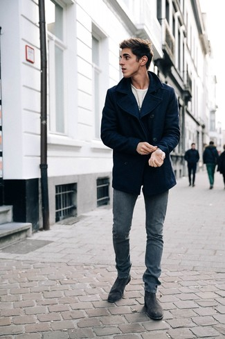 How to wear: black suede chelsea boots, navy skinny jeans, white print long sleeve t-shirt, navy pea coat