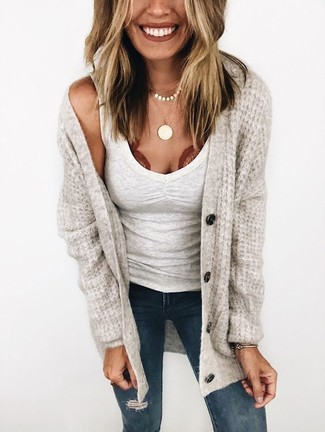 How to wear: gold pendant, navy ripped skinny jeans, white tank, beige knit cardigan