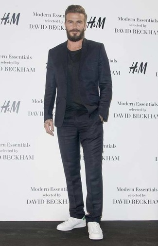 David Beckham wearing Navy Suit, Black Crew-neck T-shirt, White Leather Low Top Sneakers