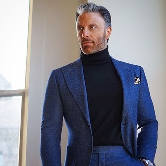How to wear: navy wool suit, black turtleneck, brown print pocket square, silver watch