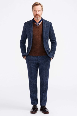 How to wear: navy wool suit, brown v-neck sweater, black leather dress boots, navy print silk scarf