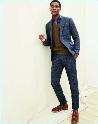 How to wear: navy wool suit, brown v-neck sweater, brown leather casual boots, blue print silk scarf