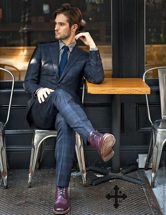 A modern man's sophisticated closet should always include such stylish essentials as a navy tartan suit and a grey classic shirt. Grab a pair of purple leather brogue boots to loosen things up. There's nothing like a knockout combo to cheer up a dull autumn afternoon.