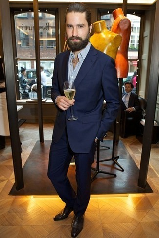 Jack Guinness wearing Navy Suit, Light Blue Long Sleeve Shirt, Dark Brown Leather Oxford Shoes