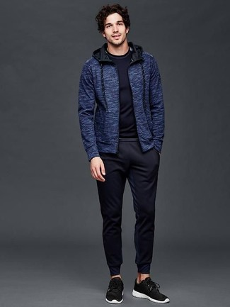 How to wear: black athletic shoes, navy sweatpants, navy long sleeve t-shirt, navy hoodie