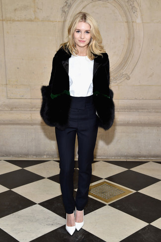How to Wear White Leather Pumps: Marrying a black fur jacket and navy tapered pants is a fail-safe way to inject your day-to-day styling rotation with some polish. When it comes to shoes, complete this outfit with white leather pumps.