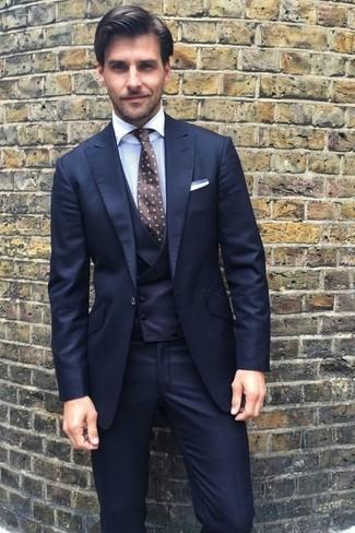 How to wear: navy three piece suit, white dress shirt, dark brown polka dot tie, white pocket square