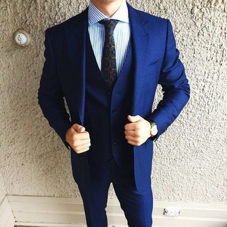 How to wear: dark green leather watch, navy print tie, blue vertical striped dress shirt, navy three piece suit