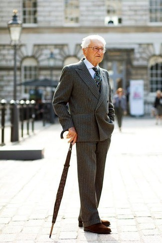 Fashion for Men Over 60: What To Wear: Consider wearing a grey vertical striped wool suit to have all eyes on you. Finishing off with a pair of brown suede chelsea boots is an effective way to bring a more relaxed vibe to your ensemble. On a mission for dressing ideas for men over 60? This combo is worth saving to your favorites.