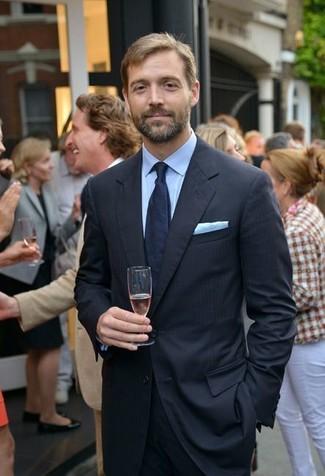 How to wear: light blue pocket square, navy tie, light blue dress shirt, black vertical striped suit