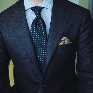 How to wear: olive print pocket square, navy print tie, light blue vertical striped dress shirt, navy suit