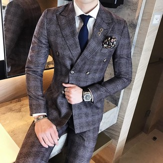 How to wear: black print pocket square, navy tie, white dress shirt, charcoal plaid wool suit