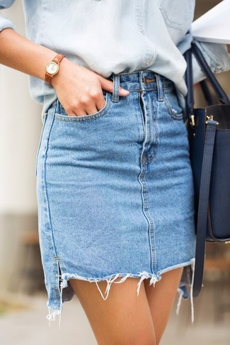 How to wear: tan leather watch, navy leather tote bag, light blue denim mini skirt, light blue denim shirt