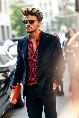This combination of a velvet blazer jacket and dark grey dress pants oozes masculinity and refined elegance.