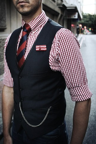 How to wear: navy waistcoat, white and red gingham dress shirt, navy jeans, white and red and navy vertical striped silk tie