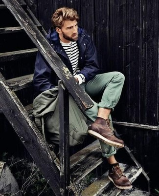 How to wear: navy windbreaker, white and navy horizontal striped long sleeve t-shirt, green chinos, dark brown leather work boots