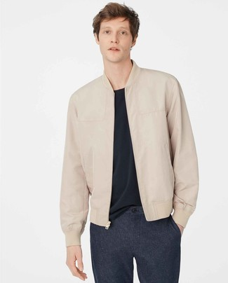 How to wear: navy wool chinos, navy crew-neck t-shirt, beige leather bomber jacket