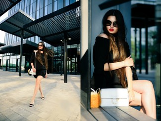 Show off your playful side in a black off shoulder top and black shorts. Add a glam twist to your getup with black leather wedge sandals. Loving how ideal this outfit is when hot weather hits.