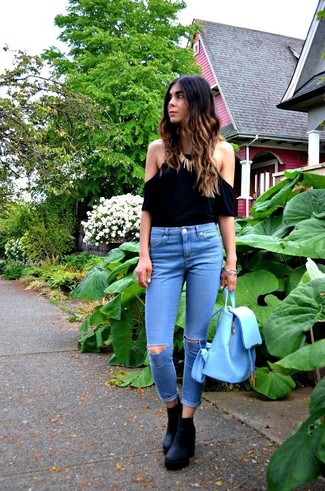 Choose a black off shoulder top and blue ripped skinny jeans to be both casual and cool. To add oomph to your look, round off with black chunky leather ankle boots. Spring calls for killer looks just like this one.