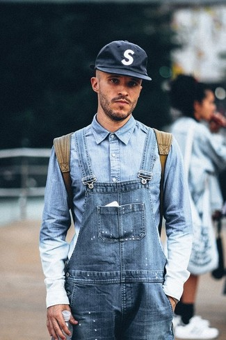 How to wear: navy baseball cap, olive backpack, blue denim overalls, light blue denim shirt