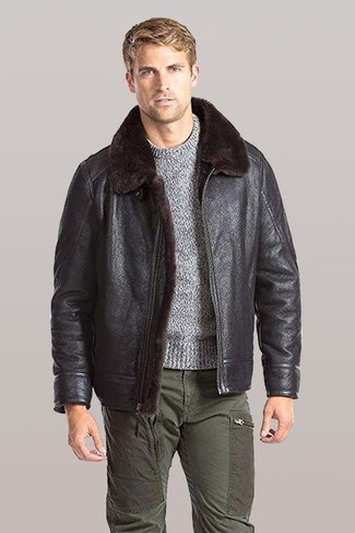 How to wear: olive cargo pants, grey crew-neck sweater, dark brown shearling jacket