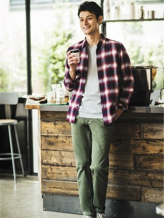 How to wear: black canvas high top sneakers, olive chinos, grey crew-neck t-shirt, white and red and navy plaid long sleeve shirt