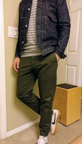 Men's Looks & Outfits: What To Wear In 2020: This combination of a navy denim jacket and olive chinos is extremely versatile and up for whatever's on your errand list today. Rounding off with white and navy leather low top sneakers is the most effective way to introduce a more relaxed feel to your look.