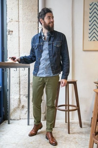How to Wear Olive Chinos: A navy denim jacket looks so nice when combined with olive chinos in a casual getup. With shoes, you can stick to a classier route with a pair of brown leather casual boots.