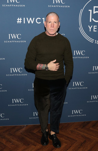 Nick Wooster wearing Olive Crew-neck Sweater, White Crew-neck T-shirt, Black Corduroy Jeans, Black Leather Oxford Shoes