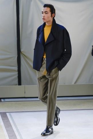 How to wear: black leather chelsea boots, olive dress pants, orange turtleneck, navy pea coat