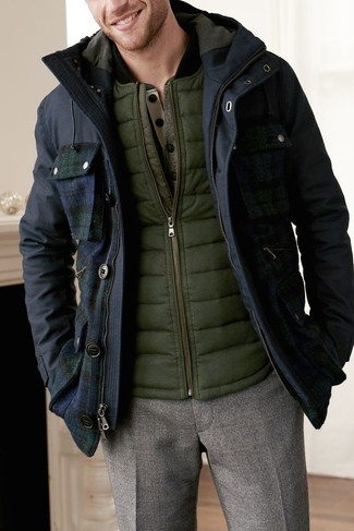 How to wear: brown wool dress pants, olive henley sweater, olive gilet, navy parka