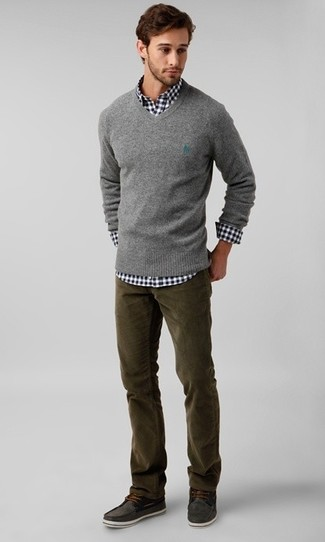 How to wear: charcoal suede boat shoes, olive corduroy jeans, black and white gingham long sleeve shirt, grey v-neck sweater