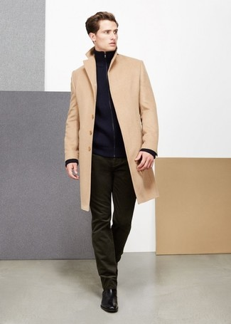 How to wear: black leather chelsea boots, olive corduroy jeans, navy zip sweater, camel overcoat