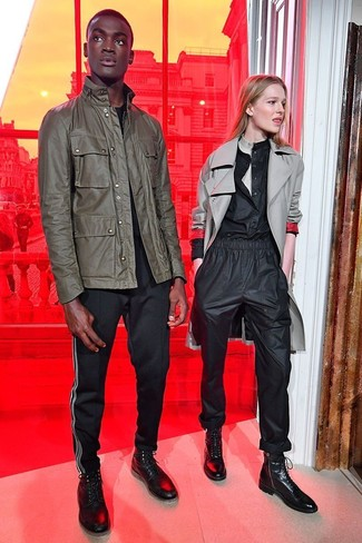 How to wear: olive military jacket, black crew-neck t-shirt, black chinos, black leather high top sneakers