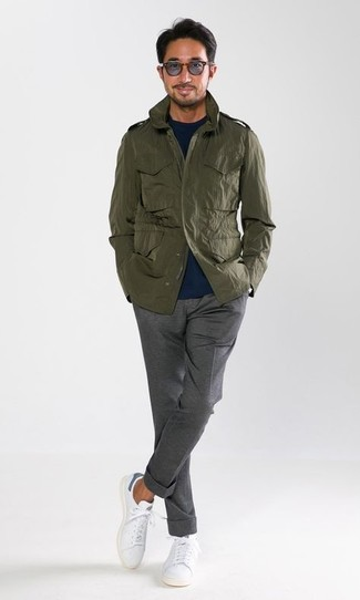 How to wear: olive military jacket, navy crew-neck sweater, grey dress pants, white leather low top sneakers