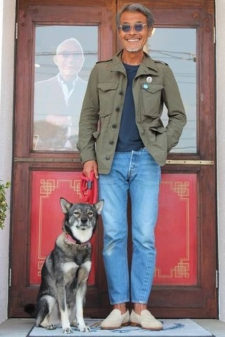 How to wear: olive military jacket, navy crew-neck t-shirt, light blue jeans, beige suede loafers